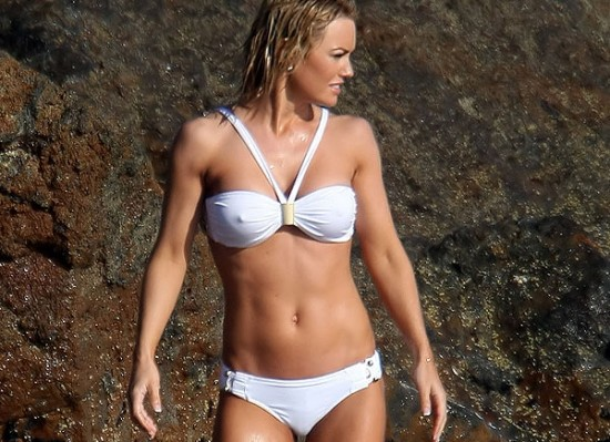 Here is Kelly Carlson showing off her killer body in a bikini which I'm ...