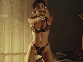 Halle Berry taking off her dress to reveal sexy black lingerie as she points ...