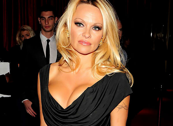Here is Pamela Anderson at the premiere of some movie and giving us great ...