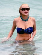 Lindsay Lohan oops boob slip in a bikini