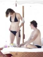 Milla Jovovich topless bikini