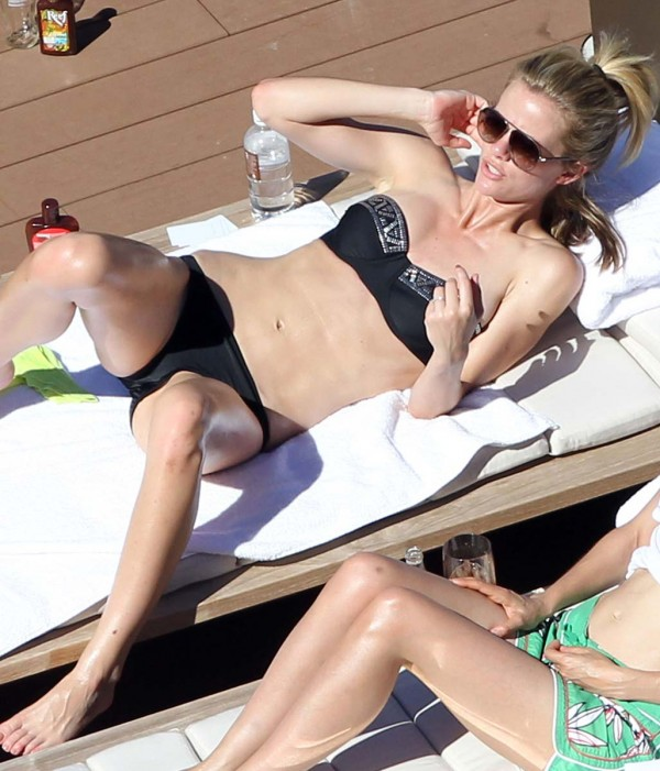 Brooklyn Decker sunbathing