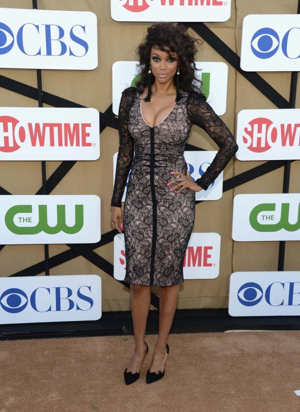 Tyra Banks Busts Out Massive Cleavage