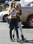 Victoria Justice bare midriff and eats corn