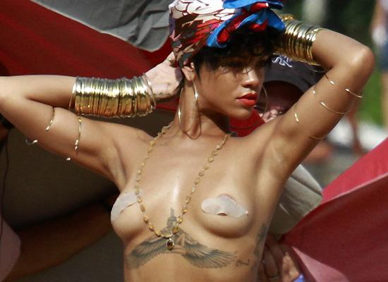 Rihanna topless for Vogue shoot